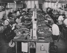 Women at workbenches wiring relays, 1950. Relays were used extensively in telephone exchanges and early computers to perform logical operations. IET Archives NAEST 211/02/16/02 E.638