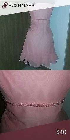Pink semi-formal dress. Salmon colored homecoming/semi formal Jordan dress. Size 2. Never worn. About knee length. Depending on height.   Feel free to make an offer! Check out my bundle discount and daily mark down. Some of the shoes listed would match great! Jordan Dresses Prom