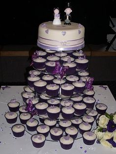 fruit cake topper and 96 cupcakes, decorated with hearts, flowers and butterflies