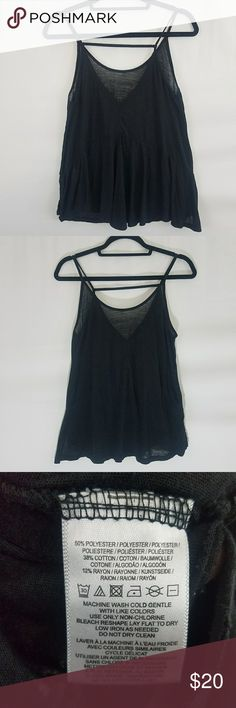 Urban Outfitters Little Black Spegetti Strap Tank Such a great flowy top paired with shorts for summer! V neck style front with fabric strap going across chest Size Xtra Small Previously loved Urban Outfitters Tops