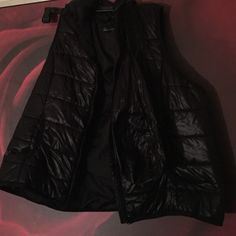 Baccini vest Black hooded best with a nice shine to it. Has a packable bag still attached to it. Baccini Jackets & Coats