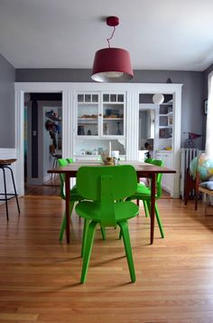 I'm unsure whether I would tire of the green chairs, but gray paint with lovely white trim sucks me in every time.