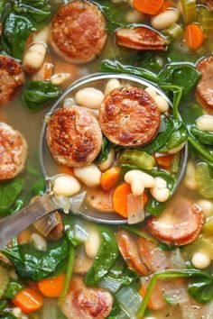 Sausage, Spinach and White Bean Soup - So hearty, so comforting, and so easy to make right in the crock-pot with just 10 min prep. Easy peasy!