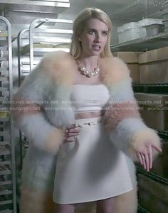 Chanel's rainbow striped fur coat and white crop top and skirt on Scream Queens.  Outfit Details: http://wornontv.net/52214/ #ScreamQueens