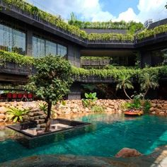 Cornwall+Gardens+is+a+huge+Singapore+home+with+a+stepped+garden+on+its+roof