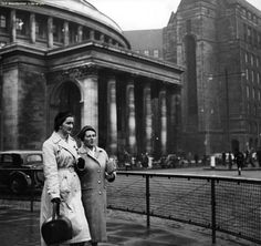 Two women walk near to Manchester Central Library, Manchester, UK, 1957.
