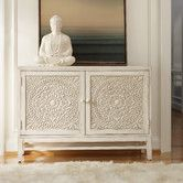 Found it at Wayfair - Melange Matisette Chest, reviewers stated this is more of a tobacco color that ivory.  I love the ivory color but would like a high gloss piece for my entryway to store shoes, dog stuff and anything else that collects by the door.  knida expensive for this use, especially if i want to shellac if,  hmm, 54W $1259.9