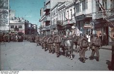 Romanian soldiers marching through Constanta, Romania ca. Some of the worst pro-Nazi savagery during the Jewish Holocaust (Shoah) took place by Romanian troops and pro-Nazi Romanian civilians. Constanta Romania, Photos Originales, Military Units, History Online, War Photography, Total War, Troops, Soldiers, World War Ii