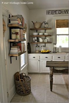 Nice kitchen decor - wood shelves with metal supports, white lower cabinets and wood island