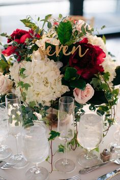 white and red centerpieces with gold details - Jimmy and Brooke Romantic Southern Wedding | flowers: Enchanted Florist - photography: AIS Portraits - ceremony venue: Wightman Chapel at Scarritt Bennett - reception venue: The Bridge Building