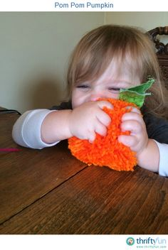 "My little guy loves ""punkees"", but most pumpkin items aren't really appropriate for a toddler. I made him this pom pom pumpkin and he seems to really enjoy it!"