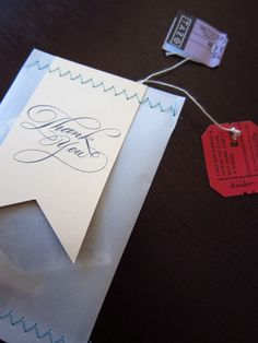 Nice wrapping idea - paper + tag + sewing