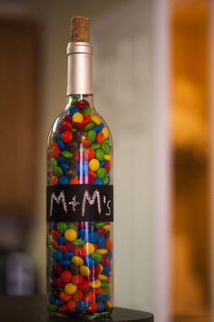 Use your wine bottles as jars for small foods like candy (M&Ms, skittles, etc.) or rice.
