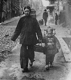 This woman is walking with her child who is dressed for Chinese New Year. Child-care and preparation for traditional festivals were two major domestic tasks for Chinese immigrant women around the turn of the 20th century. Library of Congress, Prints & Photographs Division, LC-G4085- 0158