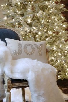 FRENCH COUNTRY COTTAGE: Sneak peek...Decking the halls-LOVE EVERYTHING:Flocked tree with white lights, chair, throw pillow!  Perfection!