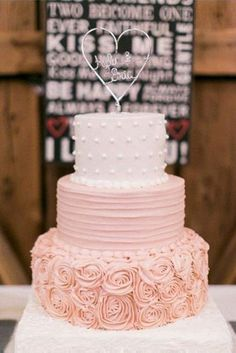 ombre wedding cakes cream pink textured with a romantic heart topper lesley's creative cakes