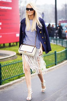 Kate Davidson Hudson tests out a nautical-inspired take on the fringe skirt by teaming hers with a Breton-stripe shirt and navy pea coat