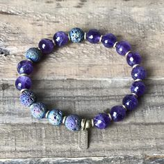 Essential Oil Diffuser Bracelet made with amethyst and titanium coated lava. #essentialoilbracelet