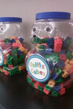 LOVE these upcycled animal cracker containers for classroom storage!
