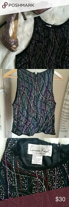 💙 3 for  $25! 🎉2X HP Insta Chic Bundle 3 items marked 💙 3 for $25 and offer $25!  Authentic vintage Lawrence Kazar New York beaded tank top.  Front and back completely beaded.  Zipper all the way up the back.  Missing maybe one or two beads but otherwise excellent condition. Black with silver, purple, blue and green beading. Runs small. Lawrence Kazar New York Tops Tank Tops