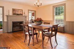Traditional Dining Room with Bennington Wood Fireplace Mantel, Pendant light, Hardwood floors, metal fireplace, Wainscoting