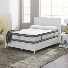 """Nothing feels better after a long day than sinking into a cozy bed, so why not choose a mattress that adds the most comfort to your space. Featuring a hybrid design, this must-have 12"""" mattress combines two leading sleep technologies. The wrapped coil base gives it orthopedic support and limits motion transfer, while the layers of memory foam provide firm comfort and spinal alignment. It also features a quilted cover for extra softness and padding. Try topping it with silky pillows, faux fur…"""