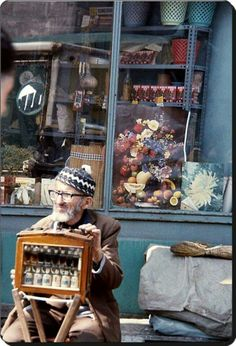 STREET SELLER: 'Esansci', selling essential oils, so that the costumer can make his/her own parfum. 1976.