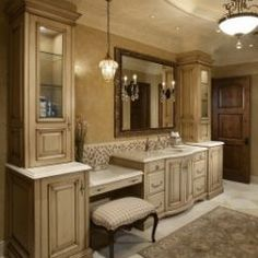 #1~ beige custom cabinets with white counters and beautiful hanging light fixtures...master bath