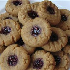 """Uncle Mac's Peanut Butter and Jelly Cookies   """"Soft, tasty peanut butter cookies with a touch of jelly on top. No flour needed."""""""