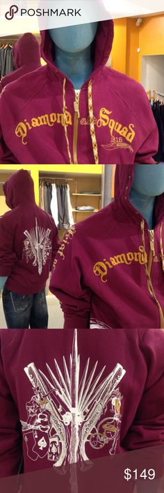 "Artful Dodger Men's ""Diamond Squad"" Hoodie (Sz. L) Artful Dodger, wine colored, ""Diamond Squad"" zip front hoodie; $149. Size L; 100% cotton (heavy weight); embroidered and screen print designs; metal stud work on pockets and hood (see pic 5). Heavy gauge zipper; intricate hood drawstrings (see pic 6). Measurements are as follow: Shoulder to shoulder 18"" Sleeve 34.5"" (from center of back collar to cuff) Shoulder to hem 28-3/4"" Armpit to armpit 24"" Cuff and waist finishing band 3""Rear design…"