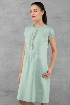Knee length light purple grey linen dress with short sleeves. The fabric is made of green and gray melange threads, what creates dusty green colour. Features side pockets, button closure at front. Will not shrink. Composition: 100 % linen. Measurements: in a last photo Sizes: EU 36-44
