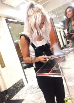 Lou Teasdale black overalls and white tank. I'm thinking docs or hightops with this. Love the hair too.