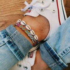 Summer Accessories Styling: Mix boho colorful beaded ankle-bracelet with seashell ankle bracelet.