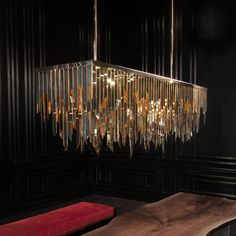 DRAMATIC CHANDELIER WITH AMAZING DETAILS | It is impossible not falling in love by this unique and dramatic chandelier | www.bocadolobo.com #homedecor