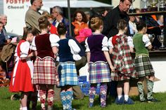Second from left - kilt with burgundy jacket from the back #Skye #Red #Tartan