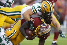 Rob Kelley #20 of the Washington Redskins is tackled by inside linebacker Jake Ryan #47 of the Green Bay Packers in the first half during a preseason game at FedExField on August 19, 2017 in Landover, Maryland.