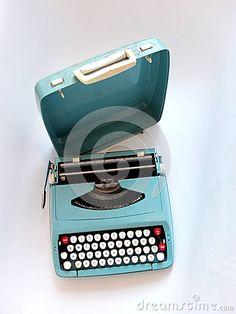 Stylish blue Vintage manual Typewriter on a white background