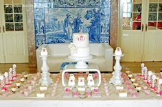 The cake stood out with the background of blue tiles, in this monogram batism