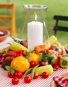 striking centerpiece that's super easy, surround a glass hurricane lamp with a jumble of the day's most colorful veggies. Go for contrasts in color, shape, and texture