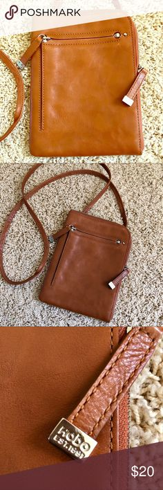 HOBO Cross Body Purse HOBO cross body purse in camel. Many compartments and great for errands, travel or an easy purse for the ultimate ladies essentials: phone📱 , ID, 💵 cash, credit/debit cards 💳 and your lipstick!💄Offers Welcomed! Bundle 3 or more listings for 15% or more off! HOBO Bags Crossbody Bags