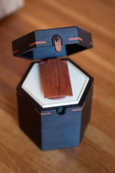 A stunning rosewood tea container with folding tea scoop by Norio Tanno.