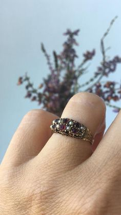 A beautiful and very fine Victorian ring crafted in 15ct gold with garnets, paste and seed pearls. A combination of six deep red garnets and red paste stones (possibly used as garnet replacements) as well as eight white bright pearls sit on the top forming a stunning ornate head with a closed back Seed Pearl Ring, Vintage Items, Vintage Jewelry, Victorian Ring, My Engagement Ring, Ring Crafts, Three Stone Rings, Garnet Rings, Diamond Flower