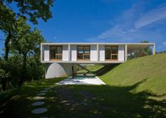 """Residential Architecture: House in Sonvico by Architetti Pedrozzi e Diaz Saravia: """"..This rural house in Switzerland by local studio Architetti Pedrozzi e Diaz Saravia is raised off the hillside on a pair of gigantic concrete columns..The single-storey House in Sonvico is constructed on a 20-metre long concrete slab, which is elevated above the ground on one side to line up with the highest level of the site..""""We and the clients both wanted to create a single-storey house,"""" architect Martino ..."""