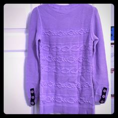 Sweater With Statement Buttons Gorgeous purple cable knit sweater with large adorable buttons on the sleeves. The cover photo is the back to show the buttons on the back of the sleeves. Worn a few times but I. Great condition! Talbots Sweaters