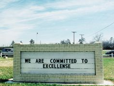 This sign shows incorrect spelling. It should say We are committed to excellence. Grammar win!