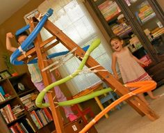 We made a marble run with pool noodles on the stairs, and the boys loved it.  I like the idea of building it around a ladder!