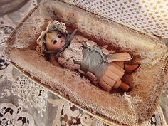 Antique doll house doll in case