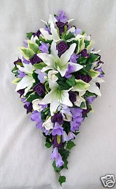 BRIDES TEARDROP BOUQUET IN IVORY LILAC AND PURPLE WEDDING FLOWERS