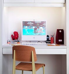 A small but functional white office space looks great with bright accents