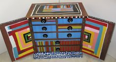 "Jewelry box painted by Sasi inspired by quilts of Gee's Bend. The quilt which inspired the inside of the doors is ""Pig in a Pen"" by Minnie Sue Coleman."